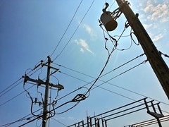 outdoor power equipment(0.0), outdoor structure(0.0), mast(0.0), street light(0.0), tower(0.0), lighting(0.0), electrical supply(1.0), overhead power line(1.0), line(1.0), transmission tower(1.0), electricity(1.0), blue(1.0), sky(1.0), public utility(1.0),