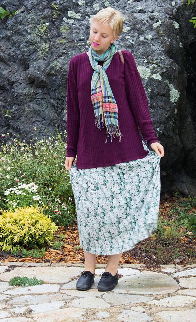 green woven scarf, long plum purple sweater, floral green dress