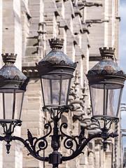 candle holder(0.0), lantern(0.0), light fixture(1.0), street light(1.0), iron(1.0), lighting(1.0),
