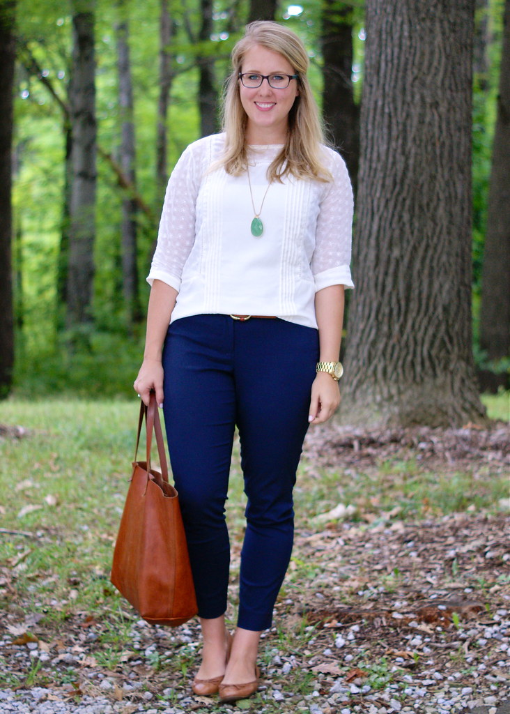 white blouse, blue pants, cognac accessories