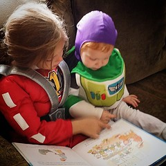 William loves it when Sicily reads to him. #HalloweenClothes #JohnGStevens #OneProudFather #LoveTheseGuys