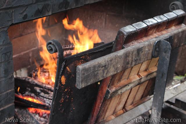 Closeup of fire smoking salmon.