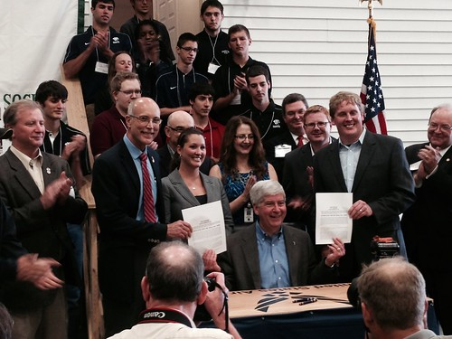 Photograph of Governor Snyder signing the legislation