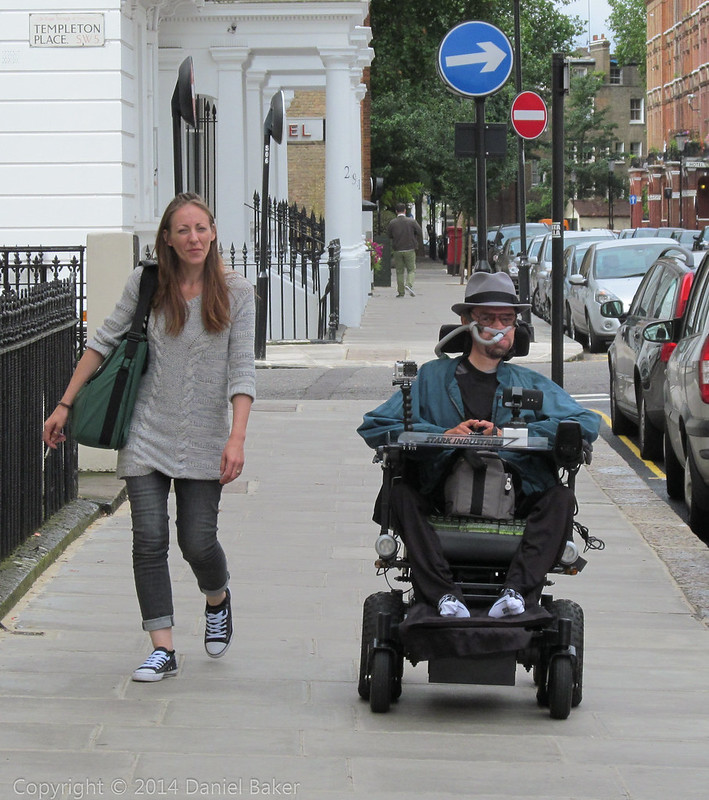 Daniel Baker with his PA walking pas Templeton Place in London