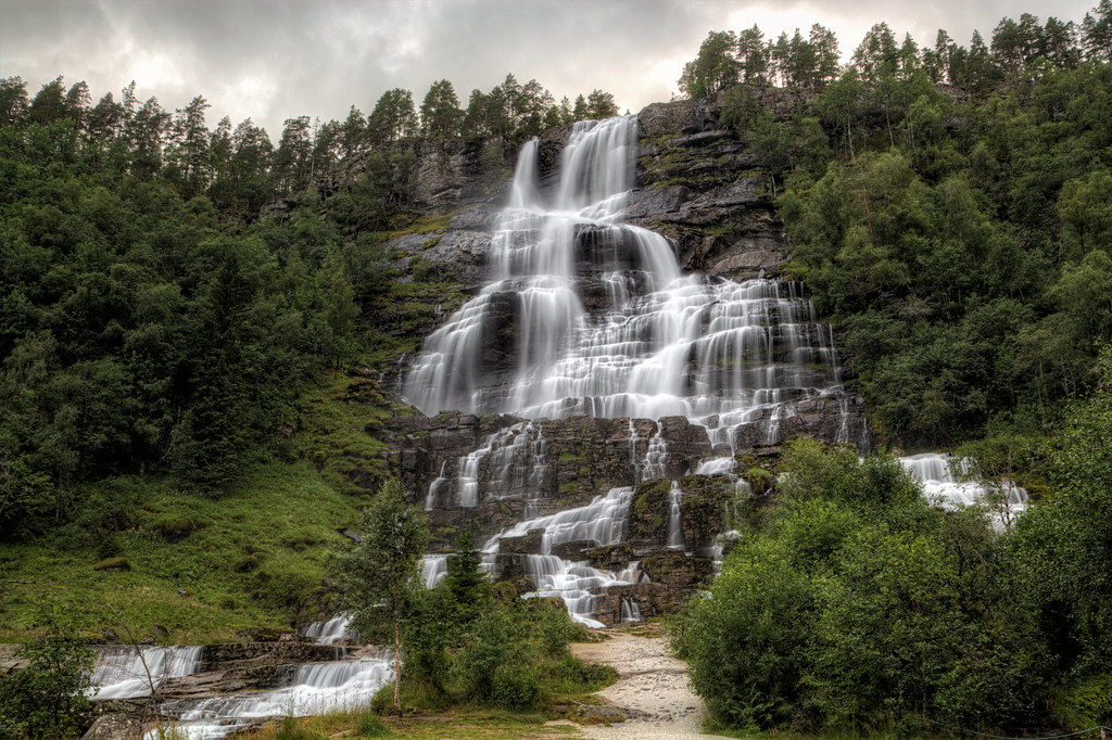 Norge 2014 Tvindefossen (also written Tvinnefossen; also called Trollafossen) is a waterfall near Voss, 150 m high