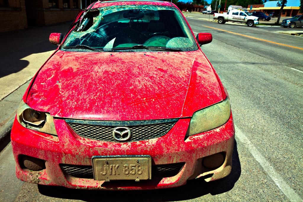 Dirty-car-with-broken-windshield--Williston
