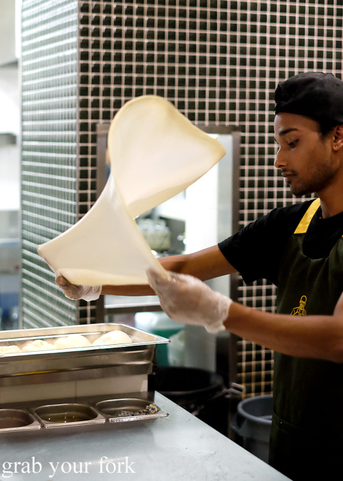 Flipping roti at Pappa Rich, Broadway