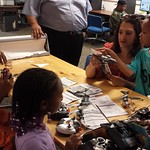 Aniya, Connor, Ronica and D'Angelo tinkering with and trying to fix the r/c helicopters