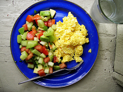 scrambled eggs and avocado, tomato, and honeydew salsa
