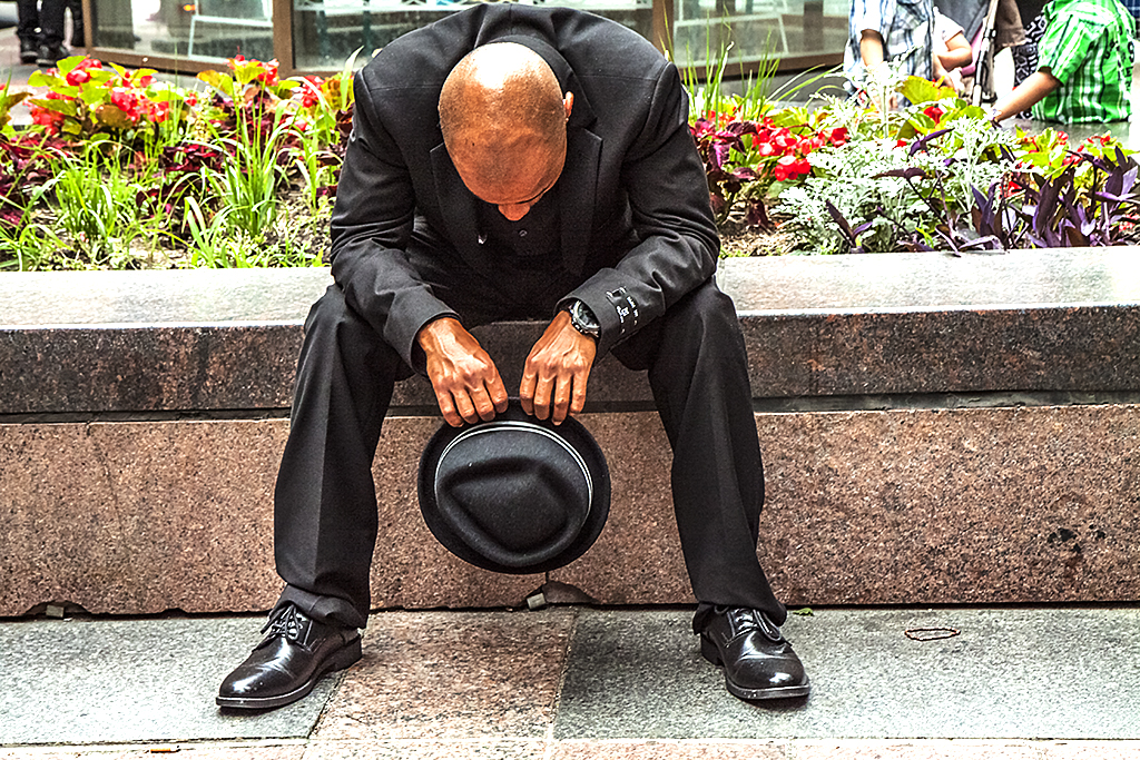 Sitting-man-with-head-down-on-7-4-14--Minneapolis