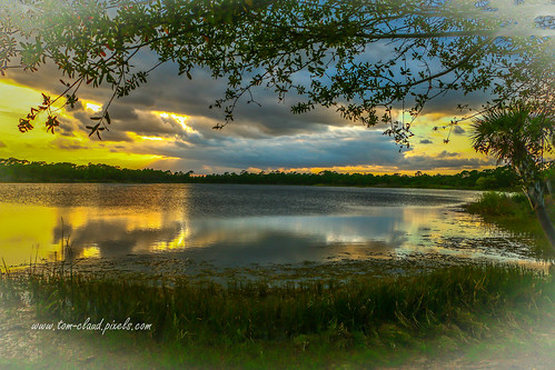 cloud clouds cloudy weather sky sun sunset lake water pond landscape nature mothernature fortpierce florida usa outdoors outside vignette vignetting
