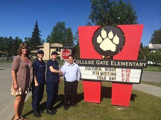 Coast Guard Lt. j.g. Veronica Swinghamer and Lt. Eva Mcelroy from Sector Anchorage, Alaska, meet with Cindy Burrill and Darrell Berntsen, principal of College Gate Elementary School, to discuss plans for conducting a Partnership in Education program throughout the 2014-2015 school year, June 4, 2014.  PIE is a Coast Guard program which provides uniformed mentors to children in need of support.  U.S. Coast Guard photo by Lt. Ryan Butler.