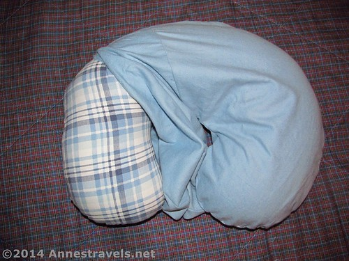 Stuffing the neck pillow into the washable cover