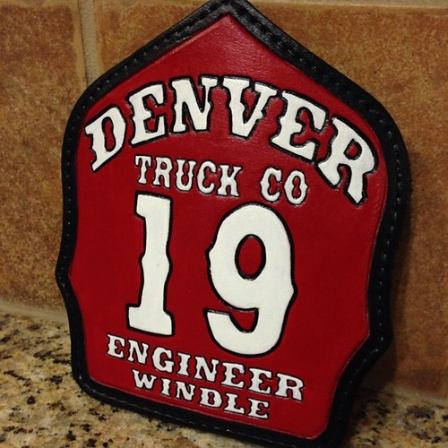 Red fire helmet shield with white numbers Denver CO