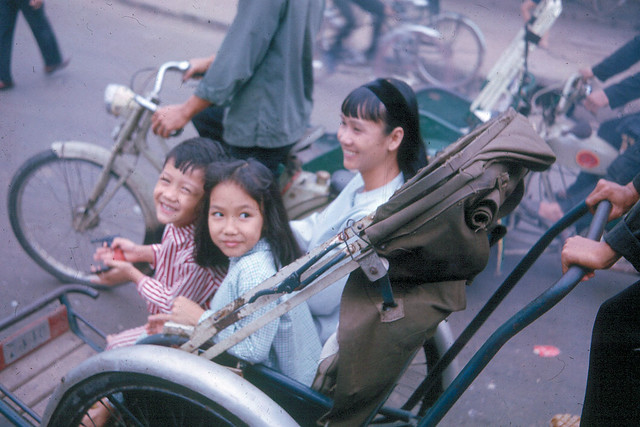 Saigon 1965 - Happy children riding cyclo