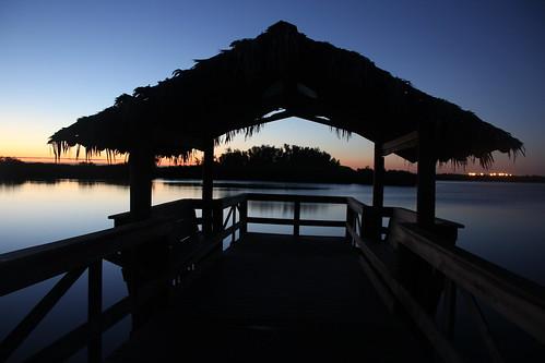 lake silhouette sunrise tikihut centralflorida calmlake