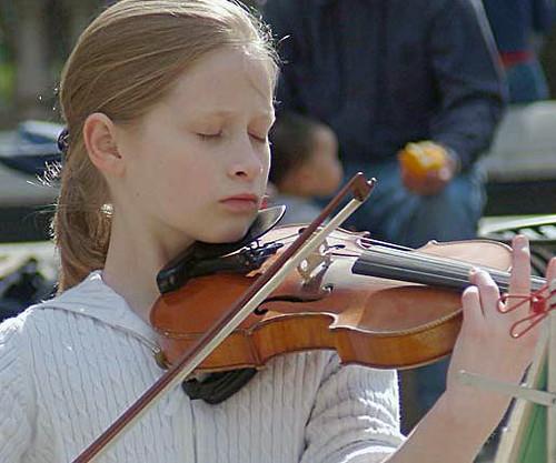 Caeli-busking-age-11