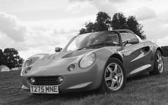 automobile(1.0), lotus(1.0), automotive exterior(1.0), vehicle(1.0), automotive design(1.0), land vehicle(1.0), luxury vehicle(1.0), convertible(1.0), lotus elise(1.0), supercar(1.0), sports car(1.0),