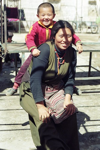 Mother with son on back (Lhasa, Tibet 1993)