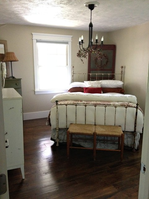 old master bedroom with iron bed