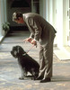 Ronald Reagan playing with his dog Lucky, at the White House, June 1, 1985