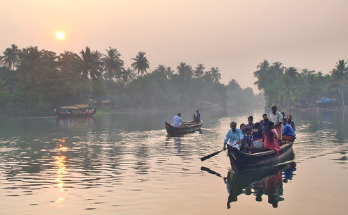 india kerala backwaters people sun sunlight sunrise water boat theindiatree river