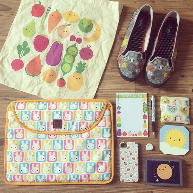 Today's #ctmonthinthelife vignette - things I've designed that I use all the time! @zazzle bunny squares laptop case, 5 A Day tote bag, vintage buttons Keds, prototype coin purse, @denydesigns sun coaster, Zazzle planet wallet, @society6 cupcake iPhone ca