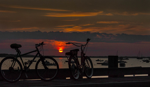 ocean morning red sea sky orange sun beach bike bicycle clouds sunrise harbor pier boat provincetown shore 2014
