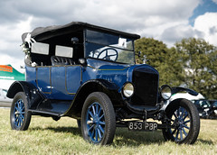 automobile(1.0), ford model a(1.0), wheel(1.0), vehicle(1.0), touring car(1.0), antique car(1.0), classic car(1.0), vintage car(1.0), land vehicle(1.0), ford model t(1.0), motor vehicle(1.0),