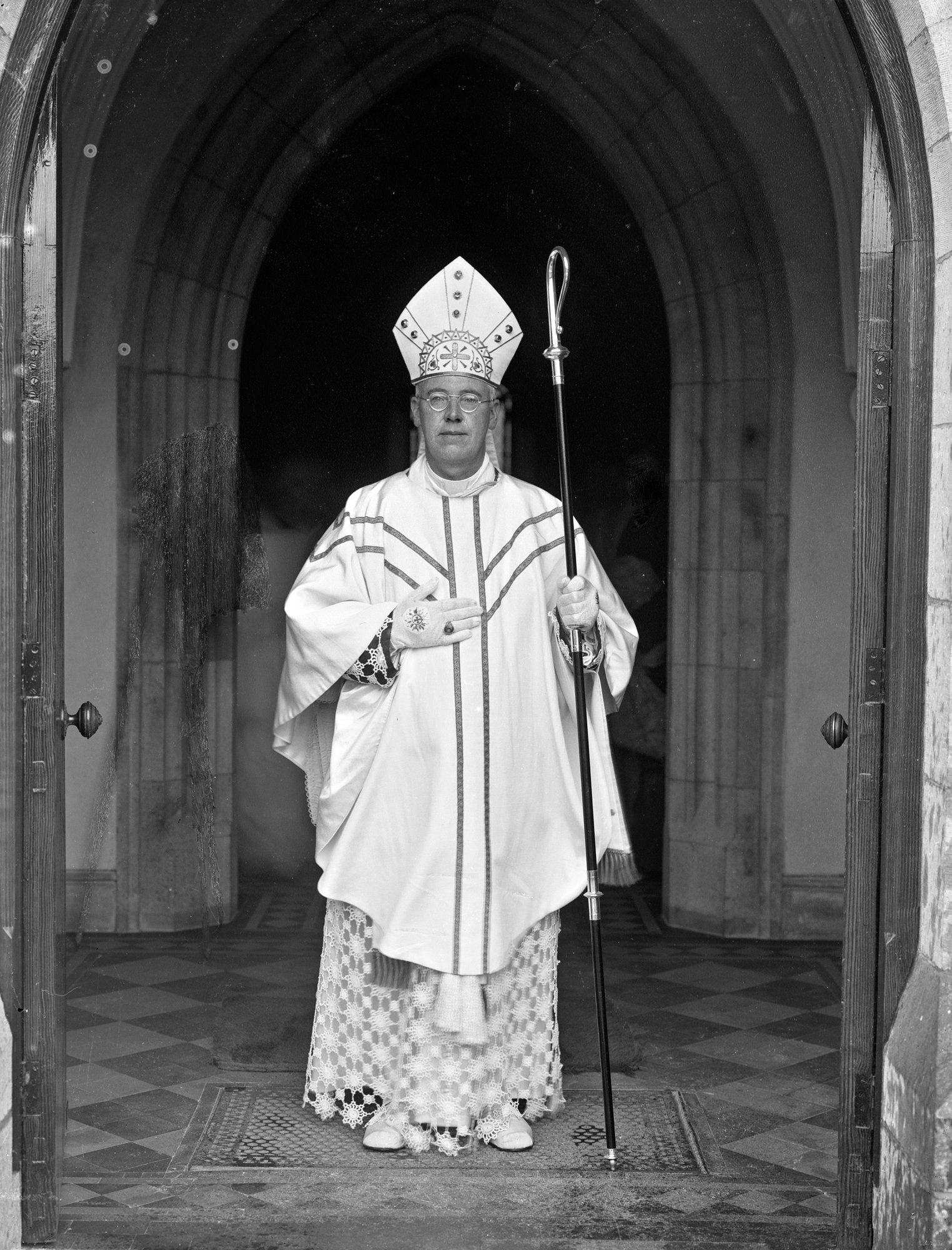 Rev. Cornelius Claffey, at church entrance, full-length portrait