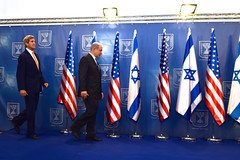 U.S. Secretary of State John Kerry takes the stage with Israeli Prime Minister Benjamin Netanyahu in Tel Aviv, Israel, on July 23, 2014, to pose for a photograph before the two sat down to discuss a possible cease-fire to stop Israel's fight with Hamas in the Gaza Strip. [State Department photo/ Public Domain]