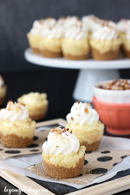 These Coconut Cream Pie Cookie Cups are just like your favorite Coconut Cream Pie but in a cookie form! A graham cracker crust with a coconut cookie, coconut pudding filling and whipped cream on top. You won't be able to stop at just on.