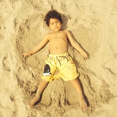 Brooks making sand angels at Malibu beach in CA. #brooks #malibubeach #california