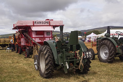 agriculture(0.0), tractor pulling(0.0), farm(1.0), field(1.0), vehicle(1.0), agricultural machinery(1.0), land vehicle(1.0), tractor(1.0),