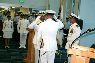 Capt. Jim Passarelli, left, is relieved by Cmdr. Jeffrey Yarosh during the Coast Guard Cutter Confidence change of command ceremony Friday, Aug. 15, 2014, in Port Canaveral, Fla. Capt. Passarelli served as the commanding officer of the Confidence since June 2012. (U.S. Coast Guard photo)