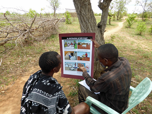 An enumerator uses a poster to obtain informed consent for research in Morogoro, Tanzania