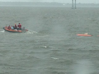 A small boat crew launched from Coast Guard Cutter Tarpon to bring two people back to the cutter after they were found adrift when their sailboat capsized , Sept. 23, 2014. Worsening weather conditions took the boaters by surprise and caused the 14-foot sailboat to capsize. (U.S. Coast Guard photo).