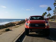 off-roading(0.0), automobile(1.0), automotive exterior(1.0), toyota(1.0), wheel(1.0), vehicle(1.0), toyota tundra(1.0), bumper(1.0), land vehicle(1.0),