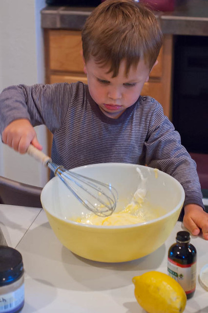 little boy mixing batter