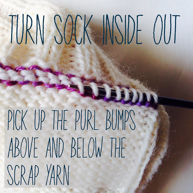 Pick up the live stitches to either side of the scrap yarn