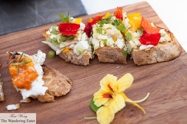 Hot smoked trout and hard boiled egg with nasturtiums from her garden bruschetta & wedge of ricotta, roast apricot, rosemary and honey bruschetta