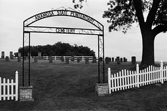Anamosa State Penitentiary Cemetery.  Forgotten stones on a lonely road.