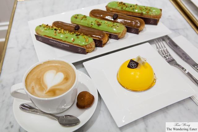 Pain au chocolat aux amandes (Chocolate Almond Croissant), Coffee & Pistachio Eclairs, Mangodor Cake, Cappuccino