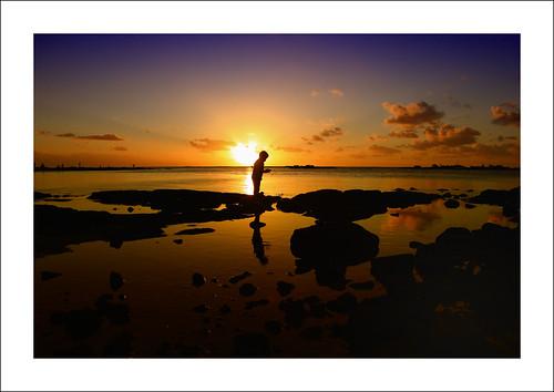 boy sunset sky sun seascape reflection art beach nature silhouette clouds island perfect rocks colours fishermen shot lagoon mauritius sunrays