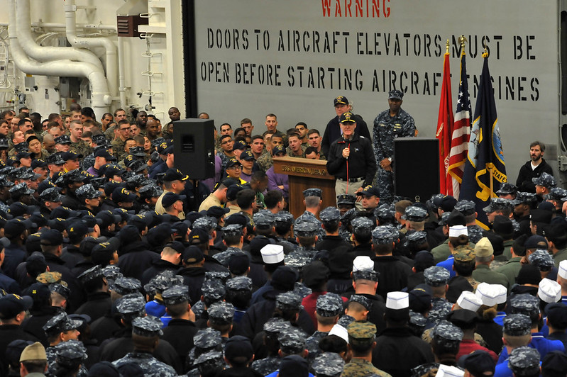 STRAIT OF MAGELLAN - Secretary of the Navy (SECNAV) Ray Mabus addresses Sailors and Marines during an all-hands call aboard the future amphibious assault ship USS America (LHA 6) as it transits the Strait of Magellan.