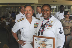 Adm. Harry Harris Jr., commander of U.S. Pacific Fleet, poses with Yeoman 1st Class Latoya Calvin after she received the National Association for the Advancement of Colored People (NAACP) Dr. Mary McLeod Bethune Inspirational Leadership Award. (U.S. Navy/MC2 Brian Wilbur)