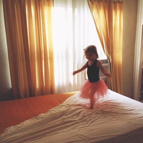 I'm trying to put the sheets on our bed but there is a ballerina in my way... #mommyhood #eisleygirl
