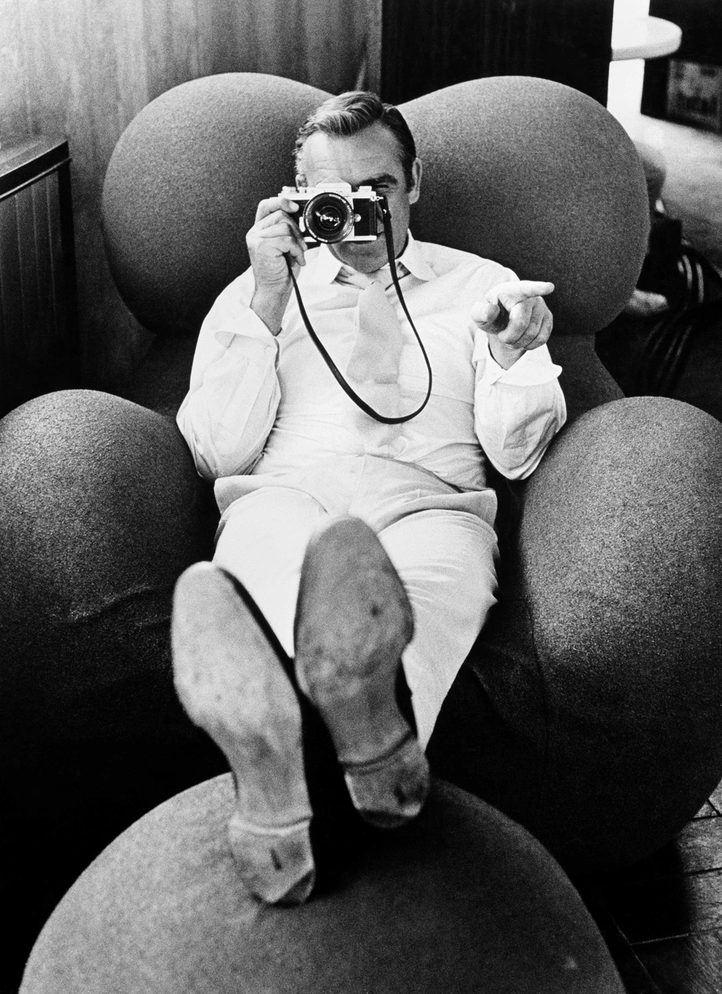 Sean Connery with camera, pointing.