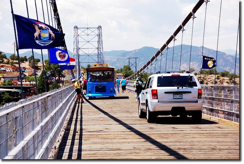 Vehicles pass the Bridge