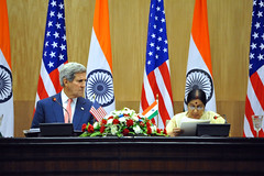 U.S. Secretary of State John Kerry listens as Indian Minister of External Affairs Sushma Swaraj addresses reporters during a news conference that followed the plenary session of a Strategic Dialogue between the two countries in New Delhi, India, on July 31, 2014. [State Department photo/ Public Domain]